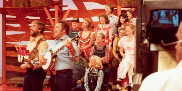 "Buck Owens filming ""Hee Haw"" with Roy Clark."
