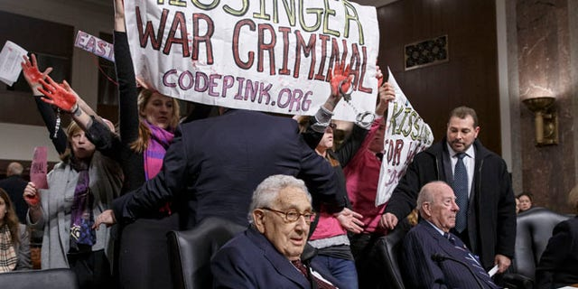 FILE: Jan. 29, 2015: Code Pink protesters at the Senate Armed Services hearing attended by former Secretary of State Henry A. Kissinger, Capitol Hill, Washington, D.C.