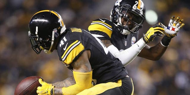 Dec 28, 2014; Pittsburgh, PA, USA; Pittsburgh Steelers defensive back Antwon Blake (41) and cornerback Brice McCain (25) celebrate a fumble recovery by Blake against the Cincinnati Bengals during the fourth quarter at Heinz Field. The Steelers won 27-17. Mandatory Credit: Charles LeClaire-USA TODAY Sports