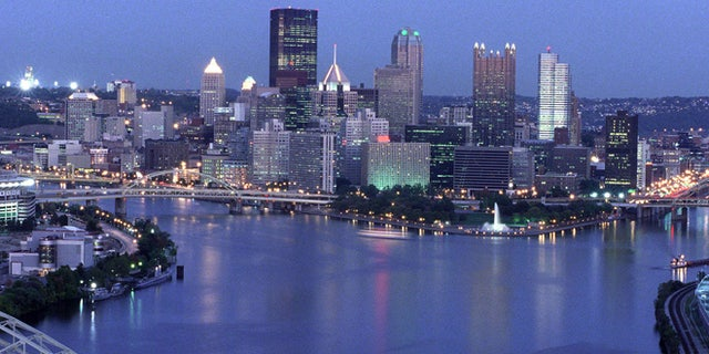 View of the downtown Pittsburgh skyline at dusk,  showing the Allegheny and Monongahela rivers joining to form the Ohio River. Three Rivers Stadium is on the left.  October 7, 1999.  (Photo by Steven Adams/Getty Images)