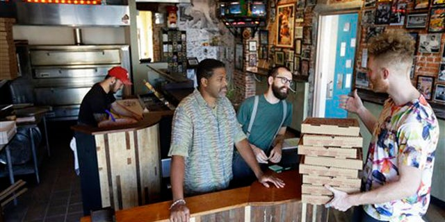 Sept. 12, 2012: The owners of Pizza Brain work the storefront.