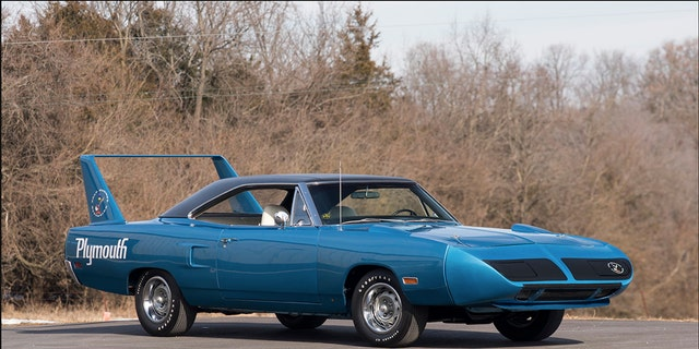 The car here has 66,000 claimed original miles equipped with a 440 cubic inch (7.2-liter) V-8 with three two-barrel carburetors, a four-speed manual and a striking B5 Blue exterior over white bucket seats.