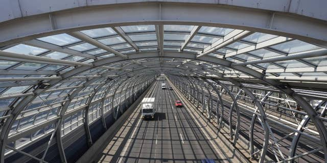 Cars drive through a soundproof tunnel covering a highway in Warsaw, Poland, Wednesday, April 30, 2014, one of the many investments built with the help of European Union funds. Poland joined the European Union a decade ago, a time that made monumental changes in the country as well as in some other former Soviet satellite states in east and central Europe. (AP Photo/Alik Keplicz)