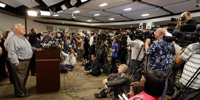 Mayor Keith Summey, left, speaks about the shooting death of Walter Scott during a news conference at city hall in North Charleston, S.C., Wednesday, April 8, 2015. Scott was killed by a North Charleston police officer after a traffic stop on Saturday. The officer, Michael Thomas Slager, has been charged with murder. (AP Photo/Chuck Burton)