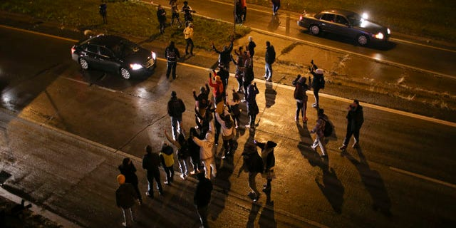Nov. 16, 2015: Marchers stop traffic on an entrance ramp to westbound Interstate 94 in Minneapolis before moving to the main freeway. The mayor of Minneapolis on Monday asked for a federal civil rights investigation into the weekend shooting of a black man by a police officer during an apparent struggle.(Jeff Wheeler/Star Tribune via AP)