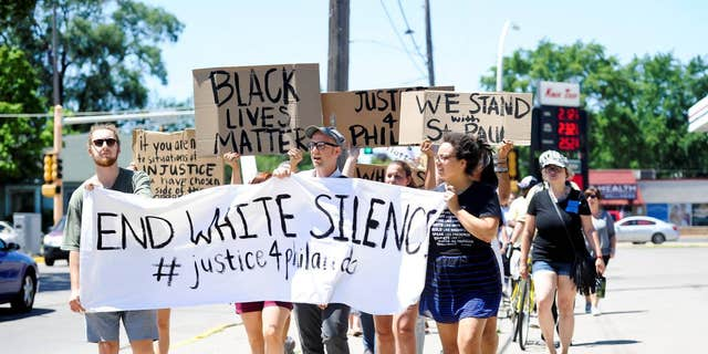 A peaceful gathering and march, Saturday, July 9, 2016, in Winona, Minn.