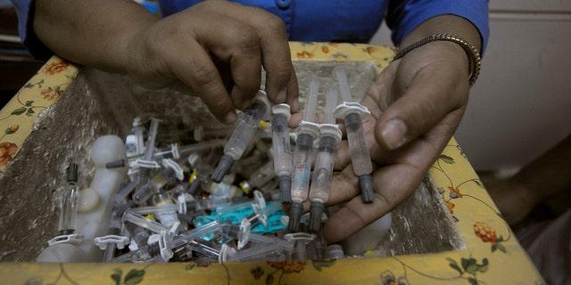 A nurse shows polio vaccines at a health center in Tegucigalpa.
