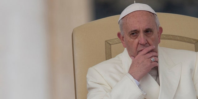 FILE -- Jan. 22, 2014:  file photo, Pope Francis attends his weekly general audience in St. Peter's Square at the Vatican.