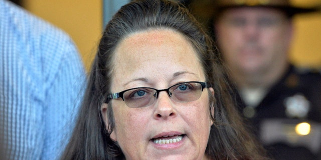 Rowan County Clerk Kim Davis makes a statement to the media at the front door of the Rowan County Judicial Center in Morehead, Kentucky. (AP Photo/Timothy D. Easley, File)