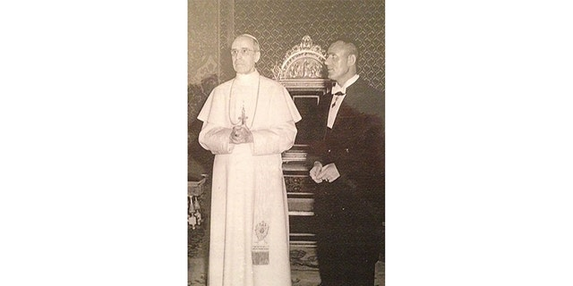 Sir John (left) with Pope Pius XII.