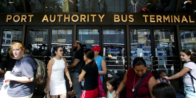 NEW YORK - AUGUST 15:  Stranded travellers gather outside the closed Port Authority Bus Terminal during a massive blackout August 15, 2003 in New York City. Power is slowly returning to certain parts of the city. (Photo by Mario Tama/Getty Images)
