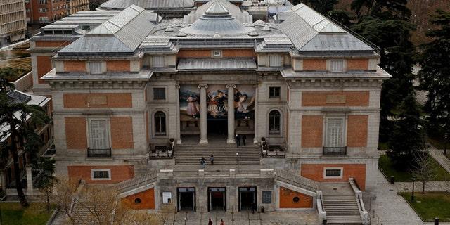 People walk around The Prado Museum in Madrid, Spain. (Photo by Pablo Blazquez Dominguez/Getty Images)