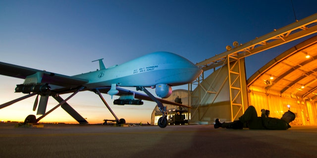 A U.S. Air Force MQ-1 Predator unmanned aerial vehicle assigned to the California Air National Guard's 163rd Reconnaissance Wing undergoes a postflight inspection at the Southern California Logistics Airport in Victorville, Calif. January 7, 2012.