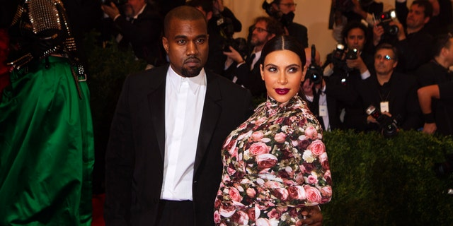 """Singer Kanye West and reality television actress Kim Kardashian arrive at the Metropolitan Museum of Art Costume Institute Benefit celebrating the opening of """"PUNK: Chaos to Couture"""" in New York, May 6, 2013."""