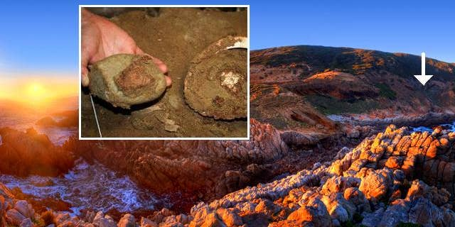 Blombos cave -- indicated at right with a white arrow -- the South African site where researchers have discovered a 100,000-year-old workshop apparently used by early humans to make, mix and store primitive paints with abalone shells (nset).