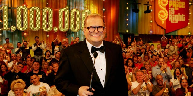 """In this February 2008 publicity image released by CBS Entertainment, host Drew Carey hosts pauses during a taping of of """"The Price is Right Million Dollar Spectacular."""""""