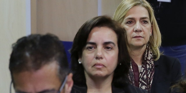 Miguel Ángel Bonet Fiol, Ana Maria Tejeiro Losada and Infanta Cristina of Spain appear in court for a hearing, where they face various charges following an investigation into the Noos Institute Sports Foundation on January 11, 2016 in Palma De Mallorca, Spain. Infanta Cristina of Spain has become the first member of the Spanish royal family to be put on trial, where she faces charges alongside her husband Inaki Urdangarin and 16 other defendants for their part in alleged corruption at the Noos Institute Sports Foundation. It is suspected that the non-profit organization, headed by Urdangarin, embezzled and laundered millions of euros worth of public funding. (Photo by Cati Cladera - Pool/Getty Images)