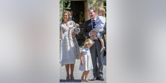 Princess Leonore stands with her immediate family, her mother Princess Madeleline, her father, Christopher O'Neil, her brother Prince Nicolas and sister Princess Adrienne.