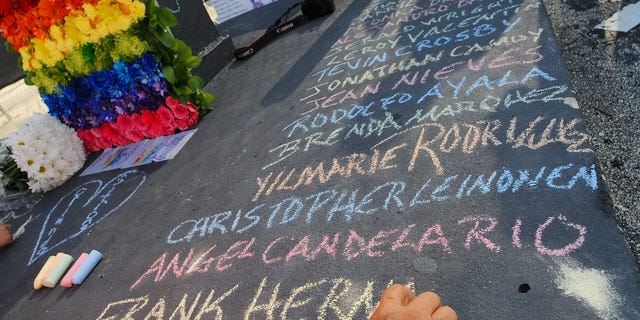 Edwin Rodriguez writes the names of the victims of the Pulse Nightclub shooting at the front of the nightclub building on June 21, 2016 in Orlando, Florida.  The Orlando community continues to mourn the June 12 shooting at the Pulse nightclub in what is being called the worst mass shooting in American history, Omar Mir Seddique Mateen killed 49 people at the popular gay nightclub early last Sunday. Fifty-three people were wounded in the attack which authorities and community leaders are still trying to come to terms with. (Photo by Gerardo Mora/Getty Images)