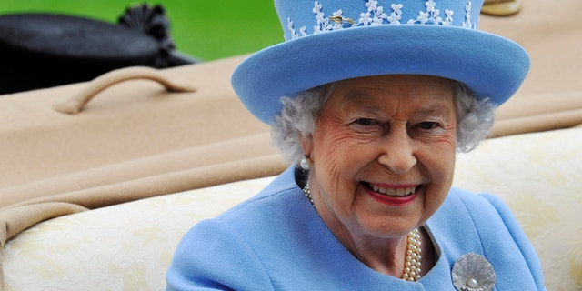 Britain's Queen Elizabeth arrives on the fifth day of the Royal Ascot horse racing festival at Ascot in southern England June 22, 2013