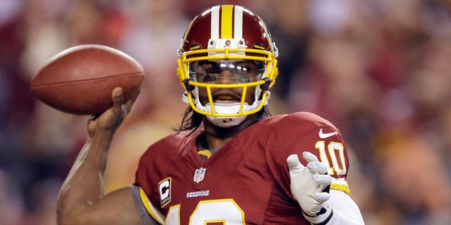 Jan. 6, 2013: In this file photo, Washington Redskins quarterback Robert Griffin III passes the ball during the second half of an NFL wild card playoff football game against the Seattle Seahawks in Landover, Md.