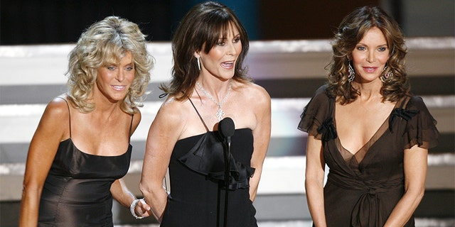 "The original ""Charlie's Angels,"" actresses Farrah Fawcett (L), Kate Jackson and Jaclyn Smith, appear during a tribute to producer Aaron Spelling during the 58th annual Prime time Emmy Awards at the Shrine Auditorium in Los Angeles August 27, 2006."