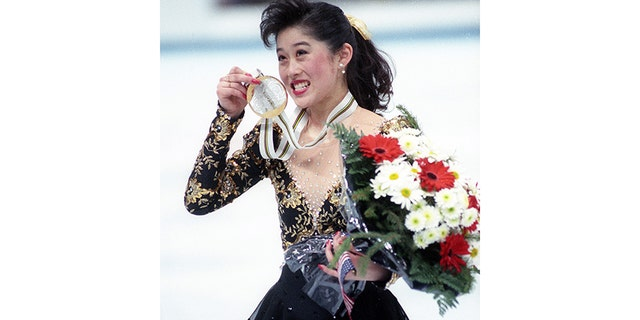 U.S.A's Olympic figure skater Kristi Yamaguchi, 21, of San Francisco, Ca., shows off her gold medal in Albertville on February 21, 1992.