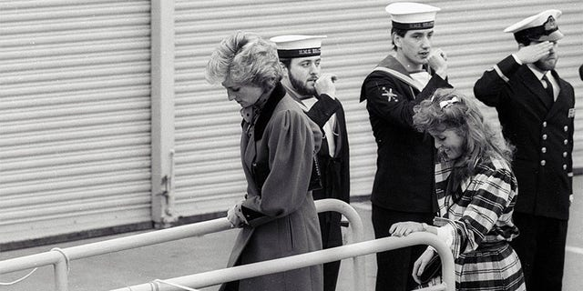 Princess Diana (L) and Sarah Ferguson board the HMS Brazen, which is moored in the pool of London on February 5, 1986.