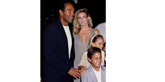 "O. J. Simpson is shown with his ex-wife Nicole Simpson and their children, daughter Sidney Brooke, 9, and son Justin, 6, at the March 16, 1994, premiere of Simpson's new film, ""Naked Gun 33 1/3: The Final Insult,"" in Los Angeles."