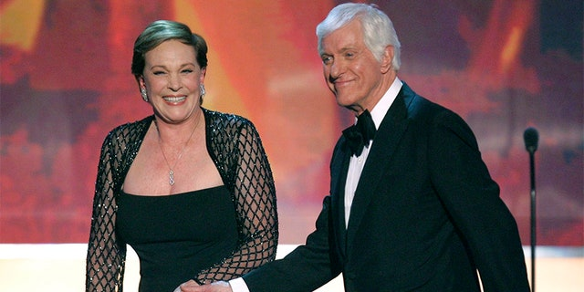 Actor Dick Van Dyke (R) and Julie Andrews hold hands after he presented her with the Life Achievement Award at the 13th Annual Screen Actors Guild Awards in Los Angeles January 28, 2007.