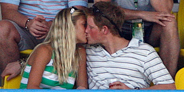 Britain's Prince Harry kisses his then-girlfriend Chelsy Davy as England plays Australia during their World Cup cricket Super Eights match in St. John's April 8, 2007.