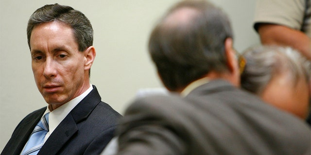 """Warren Jeffs (L) looks at his attorney during his trial in St. George, Utah, September 19, 2007. A Utah judge rejected a motion to dismiss charges against a self-described """"prophet"""" of a breakaway Mormon sect that practices polygamy after prosecutors rested their case unexpectedly early on Tuesday. Warren Jeffs, 51, the leader of the Fundamentalist Church of Jesus Christ of Latter Day Saints, is on trial on two counts of being an accomplice to rape after he presided over a wedding of a 14-year-old girl."""