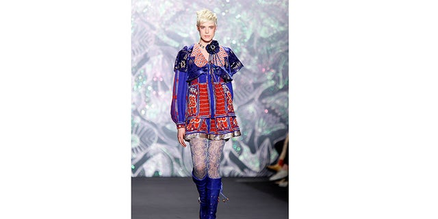 Model Agyness Deyn presents a creation for Anna Sui's 2008/2009 Fall/Winter collection during New York Fashion Week February 6, 2008.
