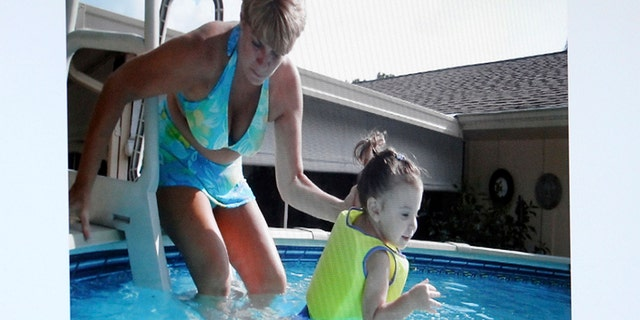 Caylee Anthony with her grandmother at the family pool in Orlando.