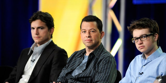 "Jan. 11, 2012: Cast members Ashton Kutcher (L), Jon Cryer (C) and Angus T. Jones (R) participate in a panel for CBS series ""Two and a Half Men"" during the CBS sessions at the Television Critics Association winter press tour in Pasadena, Calif."