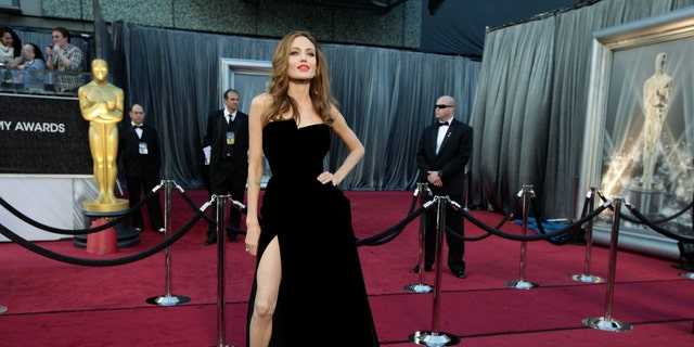 Angelina Jolie's black Versace dress and power pose went viral after she stunned at the 2012 Oscars.