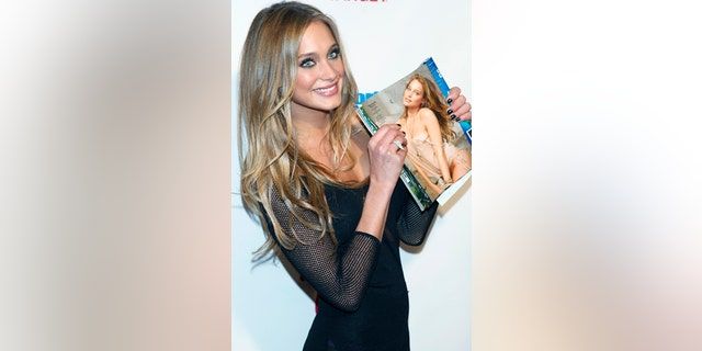 Model Hannah Davis arrives for Sports Illustrated's Swimsuit issue launch party in New York, February 12, 2013.