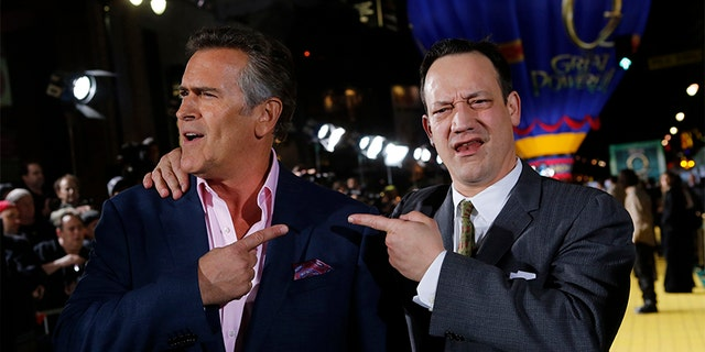 "(L-R) Actors Bruce Campbell and Ted Raimi share a light moment at the premiere of the Disney movie ""Oz the Great and Powerful"" at the El Capitan Theatre in Hollywood, California February 13, 2013."