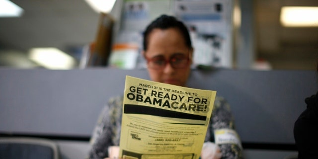 Arminda Murillo, 54, reads a leaflet at a health insurance enrollment event in Cudahy, Calif., March 27, 2014. (REUTERS)