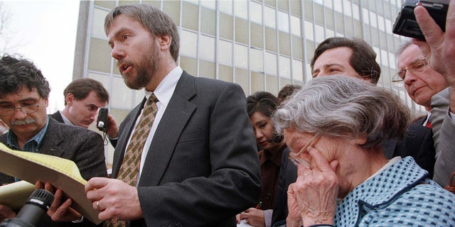 Wanda Kaczynski (R), mother of convicted Unabomber Ted Kaczynski, wipes tears from her eyes as Ted Kaczynski's brother David talks to the press outside the U.S. Courthouse in the Fred E. Moss Federal Building January 22. Ted Kaczynski pleaded guilty in court today to all charges filed against him.KACZYNSKI - RTRAPCT