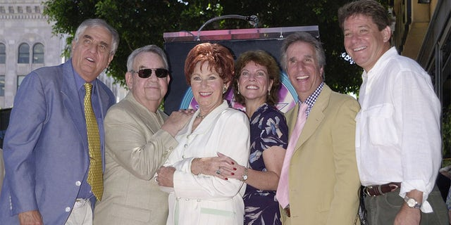 "Actress Marion Ross (third, left), who portrayed the matriarch on the television comedy series ""Happy Days,"" poses with the show's creator Garry Marshall (L) and cast members Tom Bosley. Erin Moran, Henry Winkler and Anson Williams following a ceremony honoring her with the 2,182nd star on the Hollywood Walk of Fame July 12, 2001 in Los Angeles."