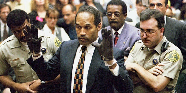 O.J. Simpson holds up his hands to the jury in this June 15, 1995 file photo.