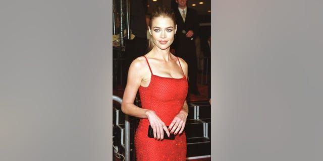 """Actress Denise Richards, one of the stars of the new James Bond film """" The World Is Not Enough"""", poses at the film's premiere November 8 in Los Angeles. In the film Pierce Brosnan portrays secret agent James Bond as he races to defuse an international power struggle with the world's oil supply hanging in the balance. Richards portrays a nuclear weapons expert in the film which opens November 12 in the United States.  FSP/JP - RTRS6UE"""
