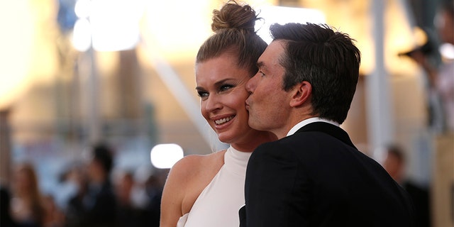 Jerry O'Connell with his wife, model/actress Rebecca Romijn.