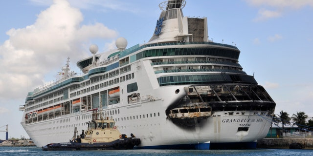 Damage on the Royal Caribbean ship Grandeur of the Seas is pictured as the ship is docked in Freeport May 27, 2013. A fire broke out on the ship's aft mooring deck in the early hours of Monday morning. The fire was extinguished at 0458 ET, and all 2,224 passengers and 796 crew members were safe and accounted for, according to the company.   REUTERS/Vandyke Hepburn (BAHAMAS - Tags: MARITIME DISASTER BUSINESS TPX IMAGES OF THE DAY) - RTX103FM