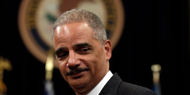 U.S. Attorney General Eric Holder looks on during a special naturalization ceremony at the Department of Justice in Washington May 28, 2013.   REUTERS/Kevin Lamarque   (UNITED STATES - Tags: POLITICS) - RTX10480