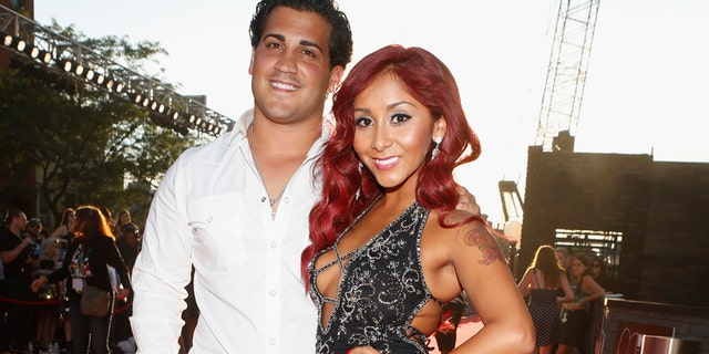 "Jionni LaValle and Nicole ""Snooki"" Polizzi arrive for the 2013 MTV Video Music Awards in New York August 25, 2013."