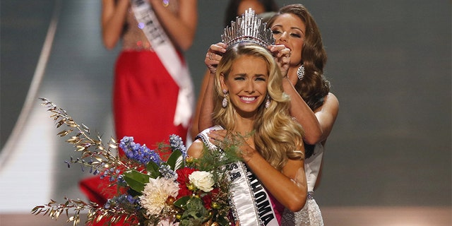 Olivia Jordan of Oklahoma is crowned by Miss USA 2014 Nia Sanchez after winning the 2015 Miss USA beauty pageant in Baton Rouge, Louisiana July 12, 2015. Fifty-one state title holders competed in the swimsuit, evening gown and interview categories for the title of Miss USA 2015.