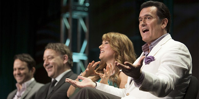 "Actor Bruce Campbell speaks, joined by showrunner Craig DiGregorio (L), director/executive producer Sam Raimi and actress Lucy Lawless, during the Starz ""Ash vs Evil Dead"" panel at the Television Critics Association (TCA) Summer 2015 Press Tour in Beverly Hills, Calif., on July 31, 2015."