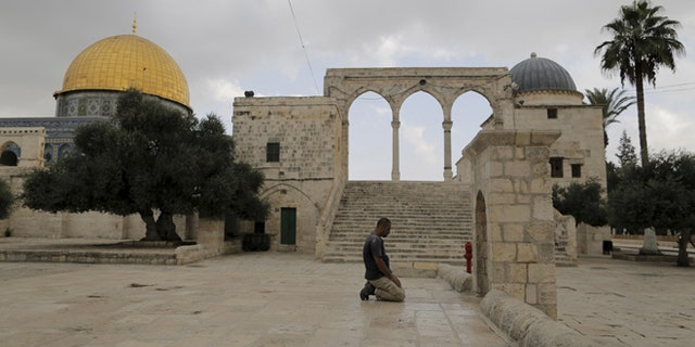 Oct. 26, 2015: A Muslim man prays near the Dome of the Rock on the compound known to Muslims as the Noble Sanctuary and to Jews as Temple Mount in Jerusalem's Old City.